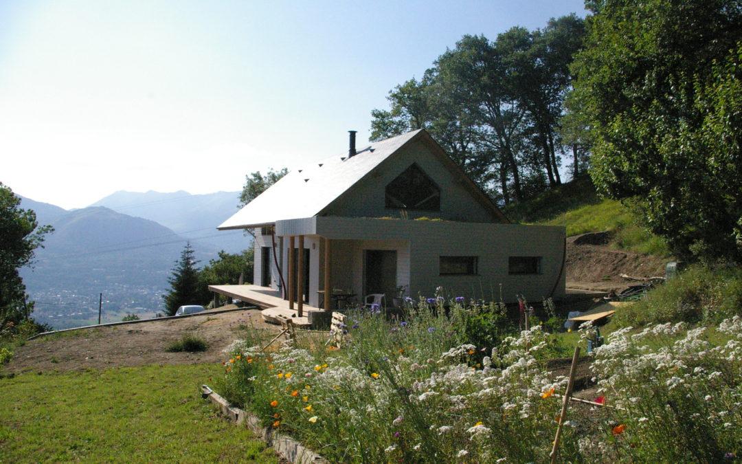 Maison d'habitation ossature bois sur terrain en pente