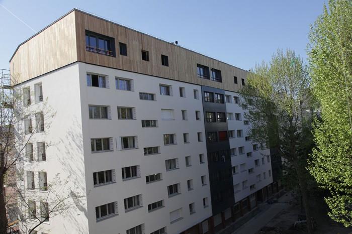 6 logements en surélévation en murs bois massif sur un immeuble des années 60 à Paris