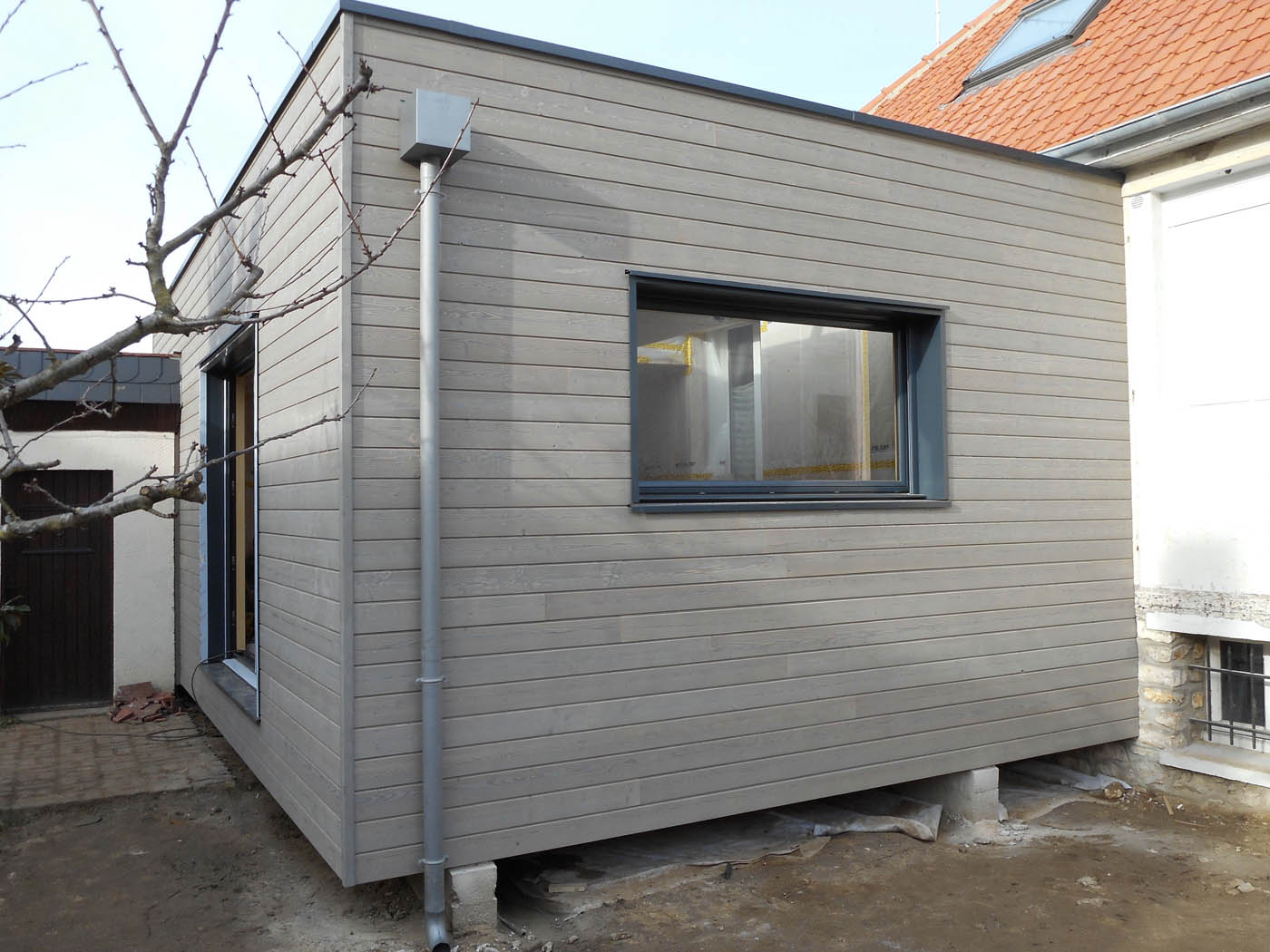 Extension maison bois prix m2 prix de du0027un garage en for Prix au m2 extension bois