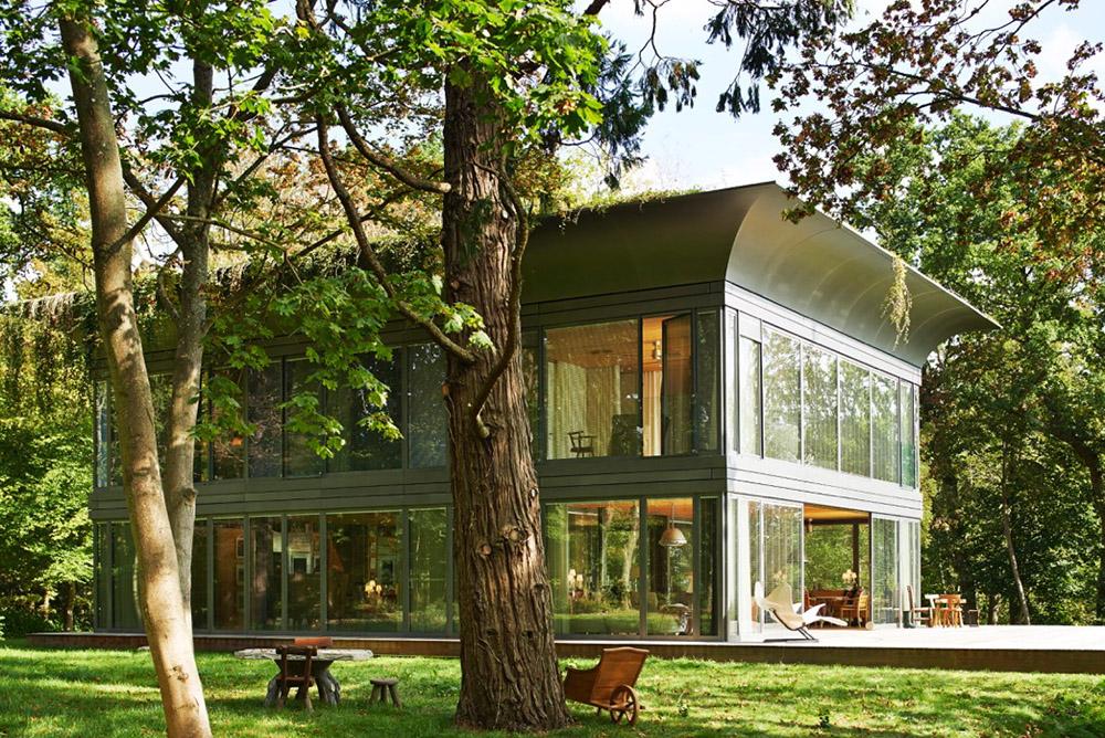 Philippe starck et riko lancent path une gamme de maisons for Maison bois et verre