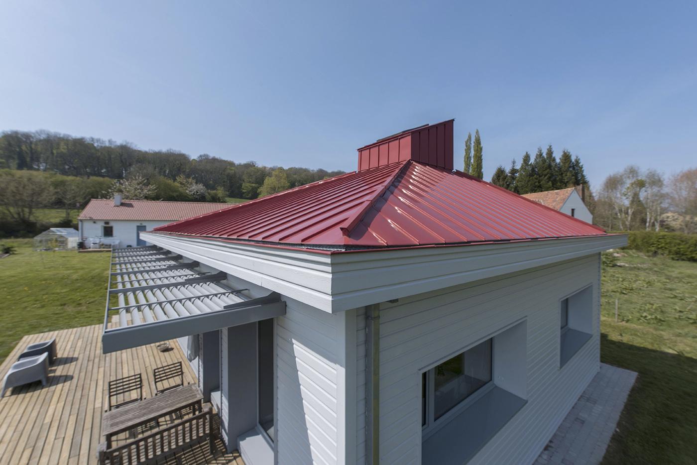 Maison passive en bois toiture color e en bac de zinc for Maison en bois nord